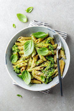 Tasty appetizing pasta with pesto sauce