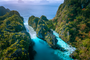 Aerial drone view of entrance to Big and Small Lagoon surrounded by steep cliffs El Nido, Palawan Philippines
