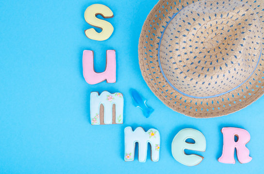 Homemade cookies with summer theme on blue background.