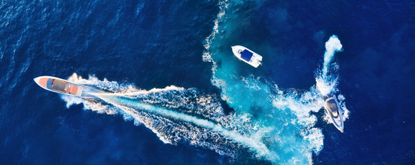 Croatia. Yachts at the sea surface. Aerial view of luxury floating boat on blue Adriatic sea at sunny day. Travel - image Wall mural