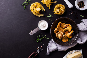 Fototapeta Cooking - tagliatelle with chanterelle mushrooms - ingredients obraz