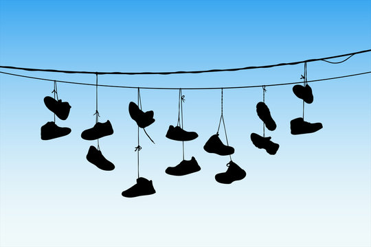 Shoes on wires. Vector illustration with silhouette of old shoes hanging on power lines. Blue pastel background
