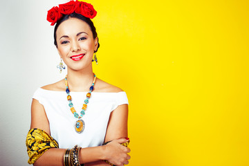 young pretty mexican woman smiling happy on yellow background, lifestyle people concept Wall mural