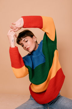 girl in colorful sweater