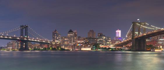 Panoramic of Manhattan bridge Dumbo Brooklyn bridge at night with long exposure