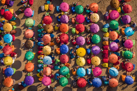 Top Aerial View of Colourful Beach Umbrellas Showing People Enjoying the Summer, Bali, Indonesia