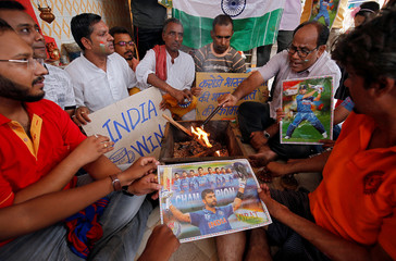 Fans offer special prayer for the victory of the Indian cricket team in the ICC Cricket World Cup semi-final against New Zealand, inside a temple in Ahmedabad