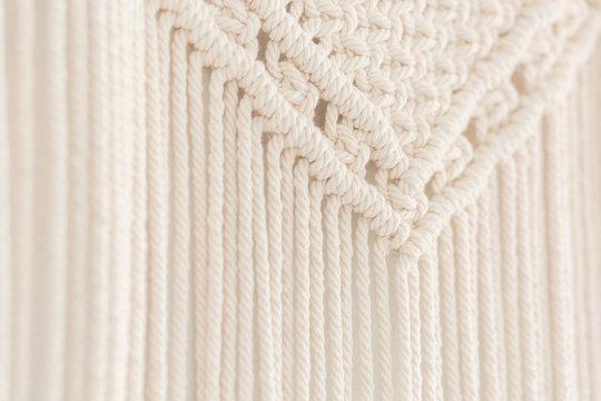 Close up of handmade cotton macrame panel. Texture. Background.
