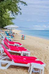 chairs and umbrella on the beach, Hermitage, Réunion