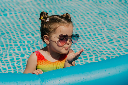 Portrait of babygirl in swimming pool.