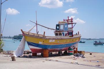 Repair fishing boat on the beach or ocean. old schooner for sea walks. Stock photo