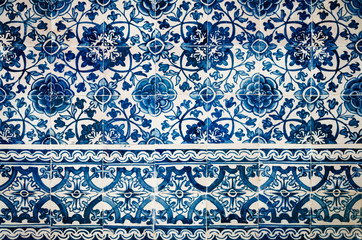 traditional portuguese azulejos, typical tin glazed white and blue ceramic tiles used to decorate walls, churches and palaces