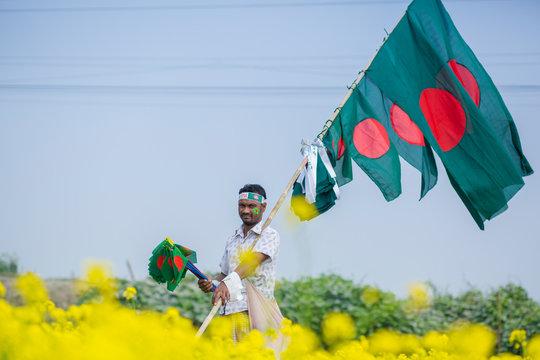 A Hawker sells Bangladeshi national flags