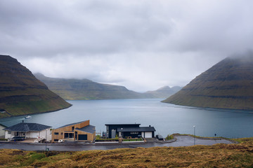 Wall Mural - Houses in Klaksvik with view over fjords and mountains in the Faroe Islands