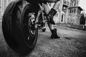 young woman on a motorcycle