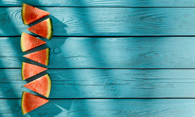 Fresh watermelon on wooden blue desk and summer time.