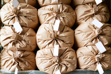 Warehouse concept. Stacked paper sacks in a warehouse.
