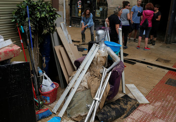 A mannequin and belongings are seen in the mud after heavy rainfall in Tafalla