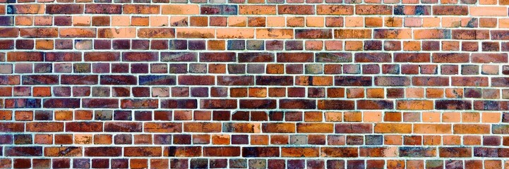 Panoramic image of brick wall with different colors. Panoramic background