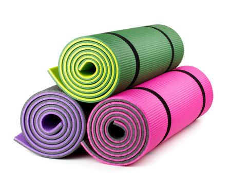 Three yoga mats isolated on white background