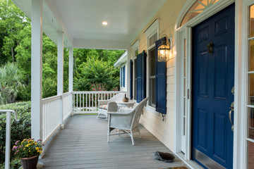 Beautiful front entrance of Southern home with covered porch.