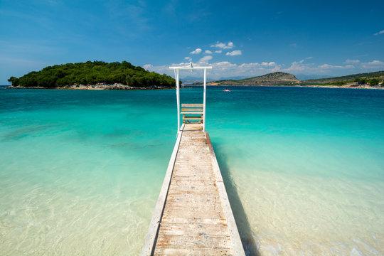 wooden pier on paradise beach in Ksamil in Albania