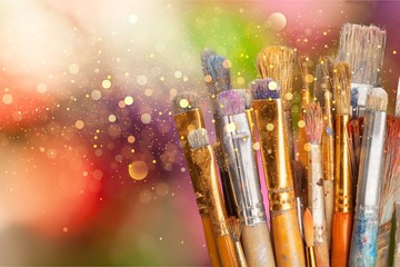 Row of artist paint brushes  on background Wall mural