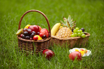 two baskets of assorted fruits