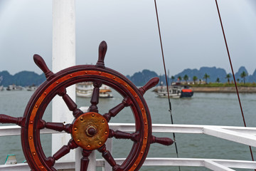 Boat steering wheel against mountains in the distant