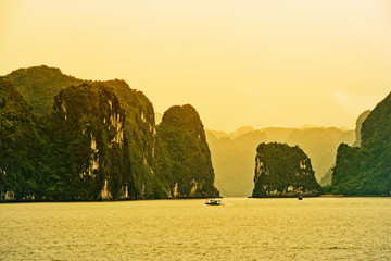 Mountain isles in Ha Long bay at sunset