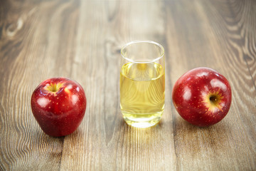 two apples and a glass of apple juice