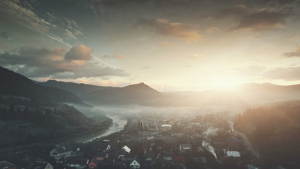 Mountain Settlement Foggy Weather Aerial View. Sunrise Highland Village Hill Chain Countryside. Overcast Colorful Sky Clean Ecology Tourism Concept. Fast Motion Drone Flight