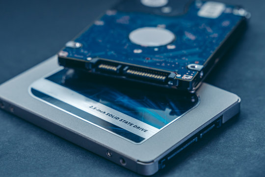 SSD drive and 2.5 HDD drive. Solid State Drive vs traditional HDD, isolated. Fast storage device vs slow.