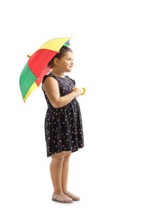Little girl holding a colorful umbrella