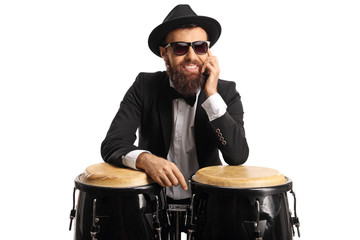 Male musician posing on conga drums