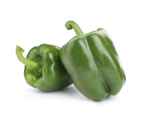 Ripe green bell peppers on white background