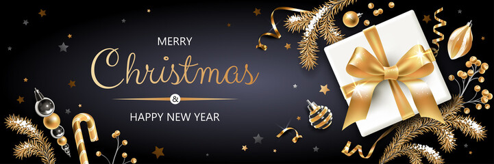 Horizontal banner with gold and silver Christmas symbols and text. Christmas tree, gift, decoration and other festive elements on black background.