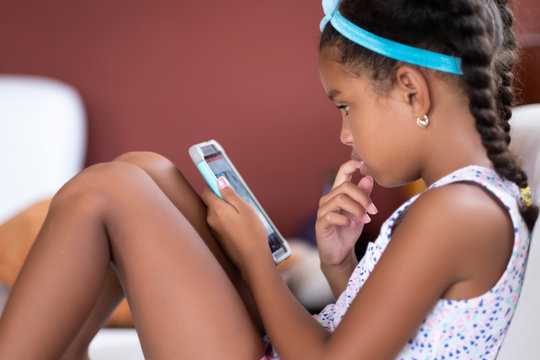 Small african american girl using a mobile phone