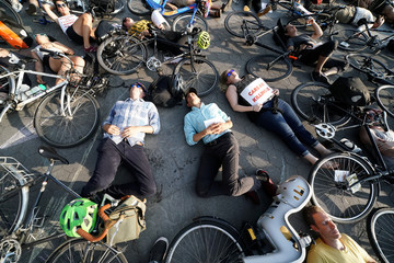 People take part in a 'Die In' protest to bring attention to cycling injuries and deaths while riding on roads, in the Manhattan borough of New York