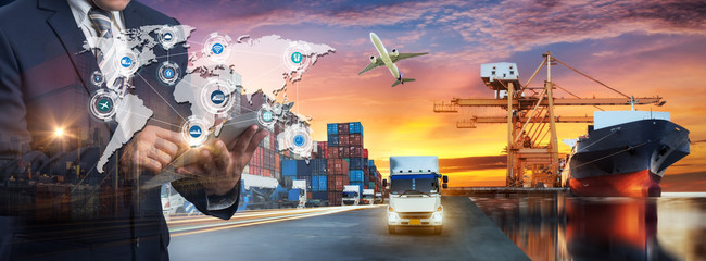 Wall Mural - Multiple exposures of Businessman touching tablet for analyze stock at logistics port and world map with logistic network distribution on background, transportation trading business concept,