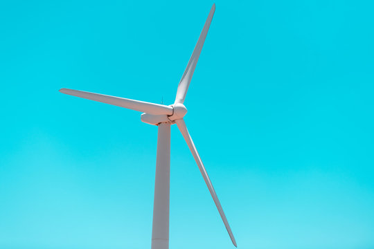 Wind turbine farm closeup near Roscoe Sweetwater Texas in USA isolated closeup of blades against turquoise sky