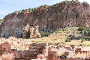 Canyon and old pueblo stone ruins at Main Loop trail in Bandelier National Monument in New Mexico during summer in Los Alamos