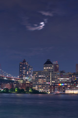 View on Dumbo from East River with full moon