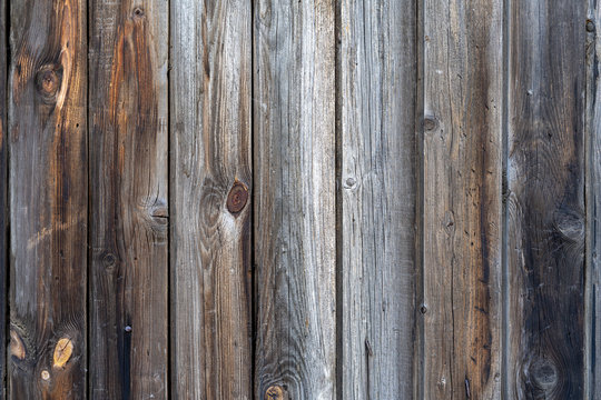 old peeling wooden boards. Background natural wooden boards. Texture of old unpainted wooden planks. Vertical arrangement of shabby wooden boards.