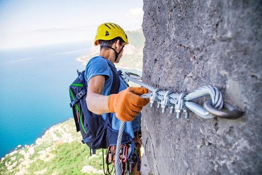 Man climbing mountain.