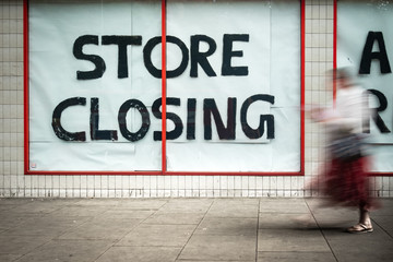 Store Closing sign in shopping high street window