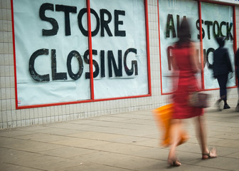 Store Closing sign on shopping high street