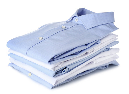 Stack of clean clothes on white background
