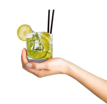 Woman hand holding cocktail in old fashioned glass with black straw