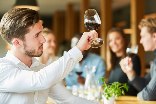 Man with wineglass at a wine tasting